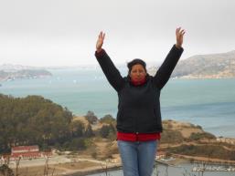 An exuberant Alicia atop a bayside hill