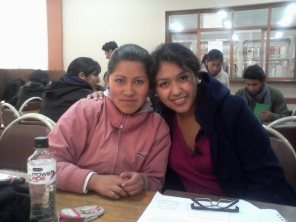 Ani, left, and her Castilian language reserch project partner in the library at their university.
