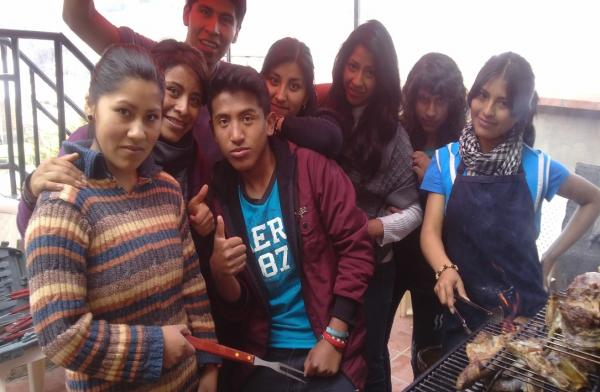Ani, left, and others from her youth group sharing a barbecue.