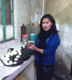 Anahi shaping bunuelos for a church youth group fundraiser to aid a young adult friend with medical needs