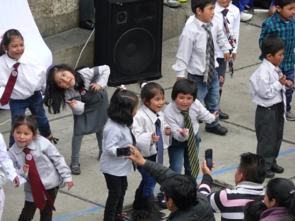 Very young f/Friends singing and dancing at Dia del Padre celebration, Los Amigos Quaker school
