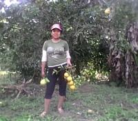 Gaby, Citrus in Hand, Helping Out on Her Parents' Farm