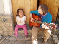 Mary and Valeria enjoying guitar time