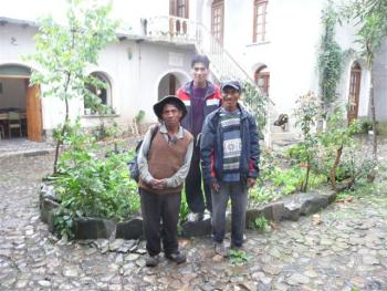 Benito Jallurana, center, with Luis and his friend, both of who ran and walked the steep Andean trails for six hours to see if their daughters were admitted.