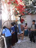Volunteers and Internado staff and students painting exterior walls