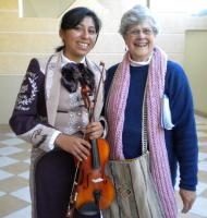 Sponsor Barbara Stanford and student Janelle Aspi share a post-music moment.