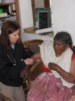 Volunteer Mylo Schaaf assists a patient during a clinic held at the Internado in Sorata