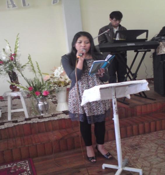 Sonia Carolina Llanque-Quispe leads worship