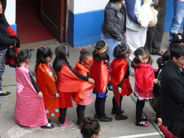 """Very young superheroes line up to show their dads how they feel about them. Los Amigos school's """"Dia del Padre"""" celebration, March 2015."""