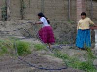 Internado students readying hoses in the new organic garden