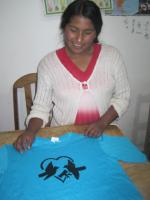 Albertina and a T-shirt with her original design, ready to sell to help pay for a field trip